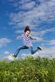 Girl jumping outdoor — Stock Photo