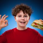 Boy eating healthy sandwich — Stock Photo