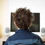 Boy using computer at home — Stock Photo