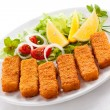 Fried fish fingers and vegetables — Stock Photo
