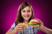 Girl eating healthy sandwich — Stock Photo
