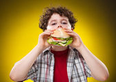 Boy eating healthy sandwich — Stock Photo