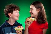 Kids eating sandwiches — Стоковое фото