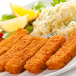 Fried fish fingers, mashed potatoes and vegetables — Stock Photo #33150331