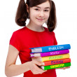Student holding books — Stock Photo
