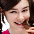 Girl eating chocolate — Stock Photo