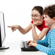 Teens using computer — Stock Photo