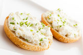 Salad and small sandwiches — Stock Photo