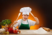 Boy making pizza dough — Stock Photo