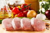 Raw pork on cutting board — Stock Photo