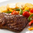 Grilled beefsteak, baked potatoes and vegetables — Stock Photo