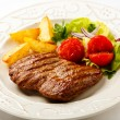 Grilled steak, baked potatoes and vegetable salad — Stock Photo