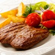 Grilled steak, baked potatoes and vegetable salad — Stock Photo #33268945