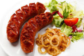 Grilled sausages and vegetables — Stock Photo
