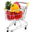 Shopping trolley full of peppe — Stock Photo