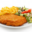 Fried pork chop, French fries and vegetables — Stock Photo