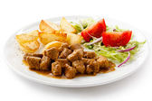 Goulash with baked potatoes and vegetables — Stock Photo