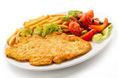 Pork chop, French fries and vegetables — Stock Photo