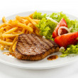 Grilled steak, French fries and vegetables — Stock Photo #33301227