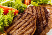 Grilled steaks and vegetables — Stock Photo