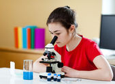 Girl examining preparation — Stock Photo