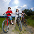 Active family biking — Stockfoto