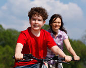 Mother with son riding bikes — Stock Photo