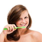 Woman brushing teeth — Stock Photo