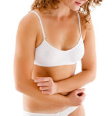 Slim woman massaging abdomen — Stock Photo