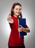 Student holding book — Stock Photo