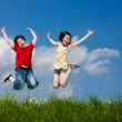 Girl and boy jumping, running outdoor — Stock Photo #33402941