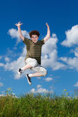 Boy jumping outdoors — Stock Photo