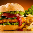 Big hamburger and French fries — Stock Photo