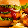 Big hamburger, chicken nuggets and French fries — Stock Photo