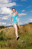 Active girl exercising outdoor — Stock Photo