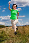 Woman jumping, running outdoor — Stock Photo