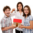 Happy family with house model — Stock Photo