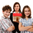 Happy family with house model — Foto Stock