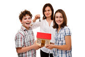 Happy family with house model — Photo