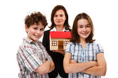 Happy family with house model — Stok fotoğraf