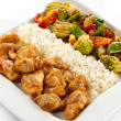 Fried chicken nuggets with rice and vegetables — Stockfoto