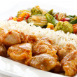 Fried chicken nuggets with rice and vegetables — Stock Photo