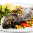 Fish dish - roasted fish and vegetables — Stock Photo