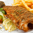 Fish dish - fried fish, French fries and vegetables — Stock Photo