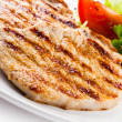 Grilled chicken breasts and vegetables — Stock Photo #33478597