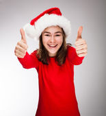 Beautiful girl in Santa Claus hat — Stock Photo