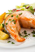 Grilled salmon, baked potatoes and vegetables — Stock Photo