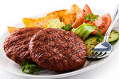 Grilled beefsteak, roasted potatoes and vegetables — Stock Photo