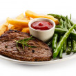 Grilled steaks, baked potatoes and vegetables — Stock Photo