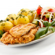 Pork chop, boiled potatoes and vegetables — Stock Photo